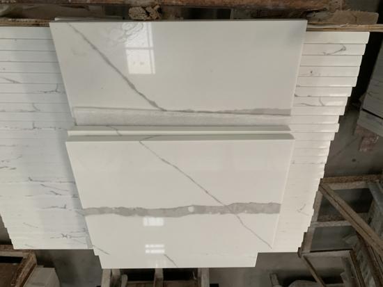 Calacatta Quartz Countertops And Backsplashes